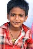 indisk le by för pojke Royaltyfria Bilder