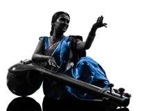 Indisk silhouette för tempuramusikerkvinna Fotografering för Bildbyråer