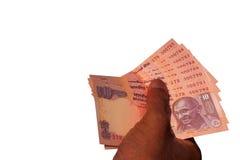 Indisk valutasedelINR 10 i handen Royaltyfria Foton