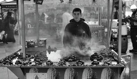 Indispensible to Istanbul roasted chestnuts. Chestnut seller of Stock Photo