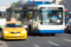 Indistinct photo yellow car taxi and bus or trolleybus closeup Stock Images