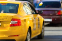 Indistinct photo yellow taxi closeup Stock Images