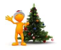Indivíduo alaranjado: Estar pela árvore de Natal Imagem de Stock Royalty Free