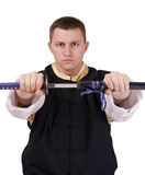 Indivíduo com espada japonesa foto de stock