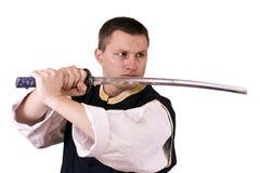 Indivíduo com espada japonesa fotografia de stock