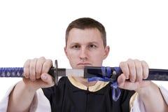 Indivíduo com espada japonesa fotos de stock
