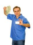 Indivíduo com ventilador dos dólares e de um cartão Imagens de Stock Royalty Free