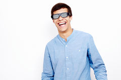Indivíduo de riso nos vidros 3D Fotografia de Stock