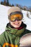 Indivíduo de sorriso com snowboard Imagem de Stock Royalty Free