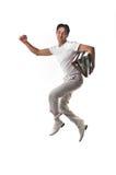 Indivíduo feliz de salto isolado no branco Fotografia de Stock