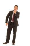 Indivíduo latino em um terno com laço vermelho fotografia de stock royalty free