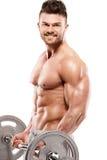 Indivíduo muscular do halterofilista que faz exercícios com peso grande foto de stock