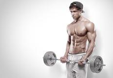 Indivíduo muscular do halterofilista que faz exercícios com peso grande Fotografia de Stock Royalty Free