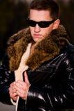Indivíduo novo atrativo no revestimento de couro do inverno Imagens de Stock Royalty Free