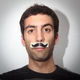 Indivíduo novo com moustaches falsificados Imagem de Stock Royalty Free