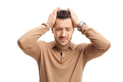 Indivíduo novo que experimenta a dor de cabeça Fotos de Stock Royalty Free