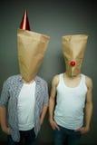 Indivíduos nos sacos de papel Fotos de Stock