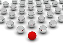 Individual. A red ball in front of a grid of shiny balls Royalty Free Stock Image