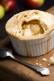 Individual Baked Apple Pie with Spoon Royalty Free Stock Image