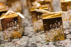 Individual boxes of Lindt chocolate. Small golden individual boxes of Lindt chocolates Stock Photo