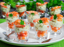 Individual Cocktail Shrimp Shooters with delicious homemade aiol. Individual Cocktail Shrimp shot glasses with delicious homemade tartar spicy sauce decorated Stock Photography
