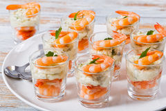 Individual Cocktail Shrimp Shooters with spicy sauce. Individual Cocktail Shrimp Shooters with delicious homemade mayonnaise spicy sauce decorated with parsley Stock Photo
