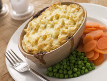 Individual Cottage Pie with Peas and Carrots Royalty Free Stock Images