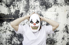Individual face clown. Crazy clown mask halloween costume and fear stock images