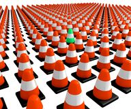 Individual in a Field of Uniformity. A crowd of traffic cones with one lone nonconformist Royalty Free Stock Images