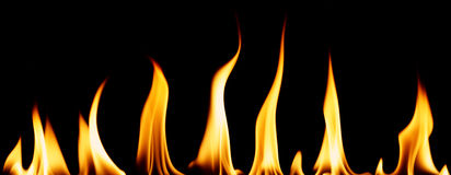 Individual flames. Series of individual flames isolated on black stock photos