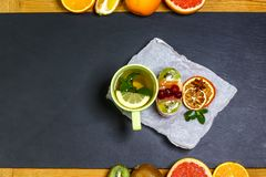 Individual fresh fruit dessert for tea on a shale board. toss sugar. top view, space for text royalty free stock photography