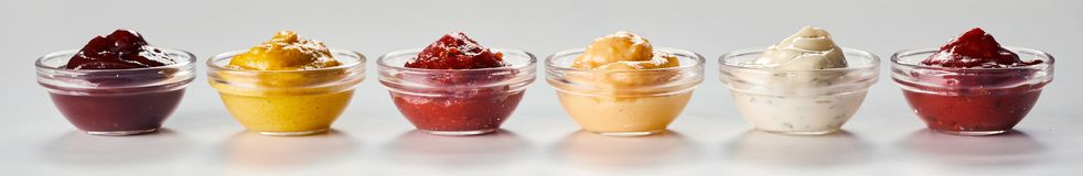 Individual glass bowls of homemade sauces stock photography