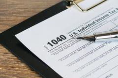 Individual income tax return form 1040, closeup shot. Individual income tax return form 1040 stock photography