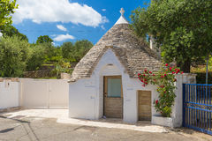 Individual inhabited trullo house, Alberobello town, Apulia region, Southern Italy. Individual inhabited trullo house with surrounding garden, Alberobello town royalty free stock image