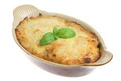 Individual Lasagna. Freshly baked beef lasagna in an individual roasting dish stock photography