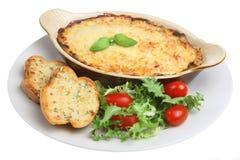 Individual Lasagne. Individual lasagna dish with garlic bread and salad. Typical 'pub grub royalty free stock photos