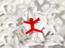 Individual Person. Conceptual photography. A paper cut out person standing out from the rest Stock Photo