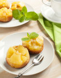 Individual pineapple upside-down cakes. Stock Image