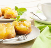 Individual pineapple upside-down cakes. Royalty Free Stock Photo