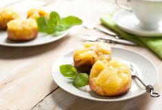 Individual pineapple upside-down cakes. Served on plate Royalty Free Stock Photos