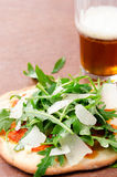 Individual pizza snack with beer Stock Image