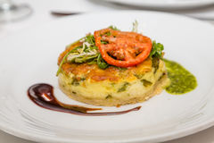 Individual Quiche with Tomato and Arugula. Stock Image