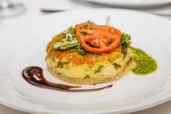 Individual Quiche with Tomato and Arugula. Stock Image