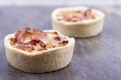 Individual quiche. Two individual mini quiches on a board royalty free stock photography