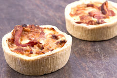 Individual quiche. Two individual mini quiches on a board royalty free stock image