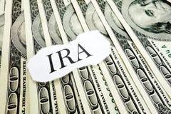 Individual Retirement Account. IRA message on hundred dollar bills Royalty Free Stock Photos