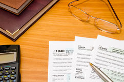 1040 individual return tax form for 2016 year. With glasses and pen Royalty Free Stock Image