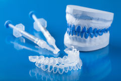 Individual set for teeth whitening. Over blue Royalty Free Stock Photo