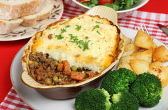 Individual Shepherds Pie. Served with broccoli and sauteed potates Royalty Free Stock Image