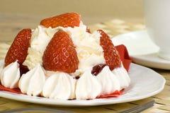 Individual strawberry pavlova. Individual pavlova mirangue with strawberries and fresh whipped cream Stock Photos